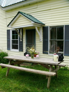 The yellow farmhouse at Windhorse farm is a warm and welcoming place to call home.